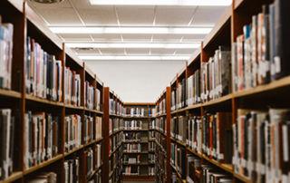 Bookshelves in library.
